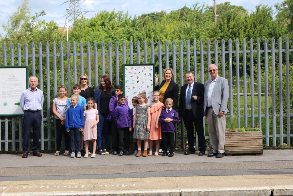 John Spencer, Carly Welch, Anna Beck, Amber Rudd MP, Kevin Boorman and Trevor Davies at Ore station with some pupils from Baird Academy, with their artwork at Ore station
