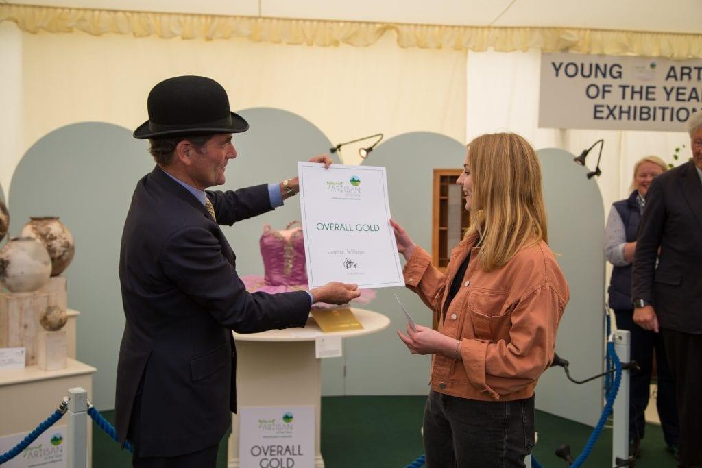 Jasmine receiving her award