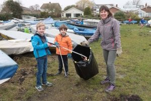 Victoria Lovell with Isaac Lovell and Jack Addison cleaning the boat park