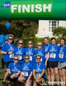 Worthing local running group, Foxy Ladies, at the finish line showing their support for Turning Tides