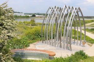 A memorial bench and 11 individually crafted arches sit alongside the River Adur in Shoreham