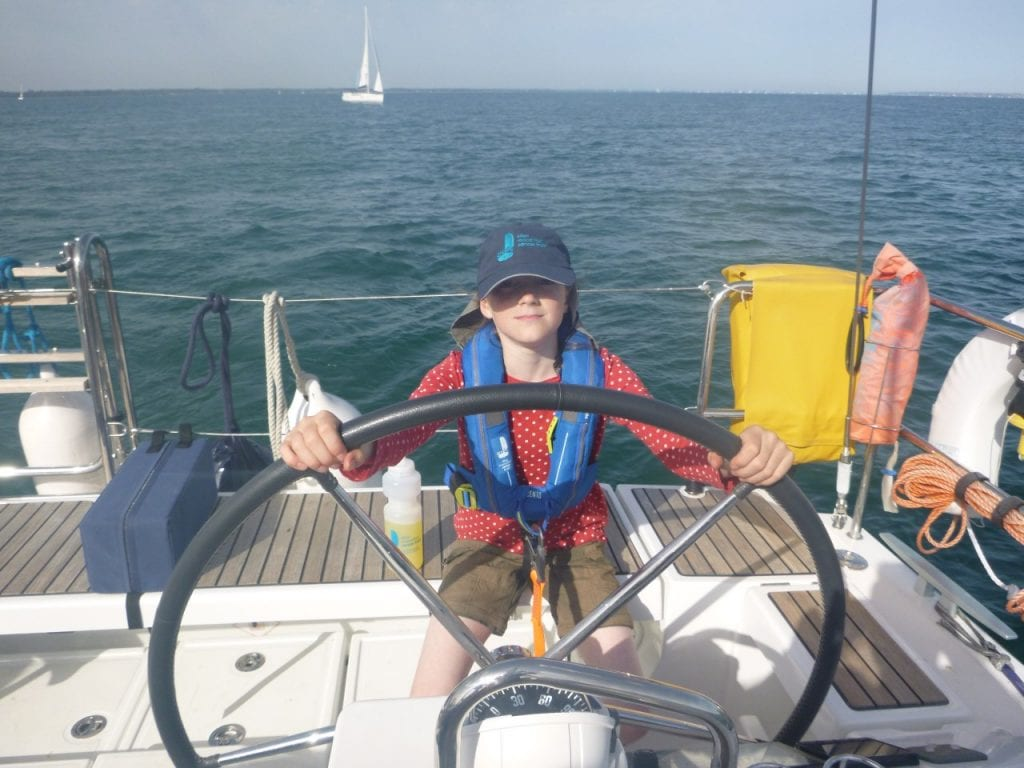 Vanessa helming the Ellen MacArthur Cancer Trust boat