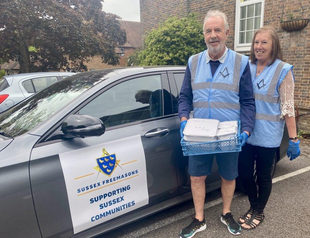 Food Donation. Graham & Jan Watkins - Horsham Freemasons with a hot food delivery